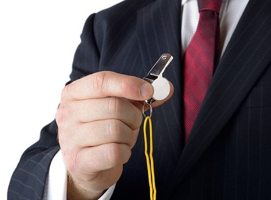 Closeup of businessman with whistle