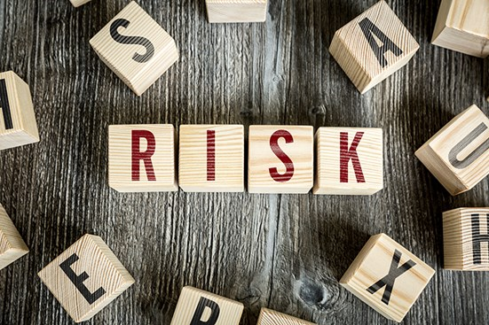 Wooden blocks spelling out RISK