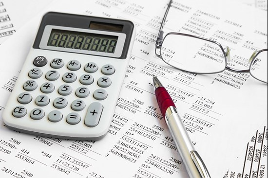 Calculator and spreadsheets with pair of glasses