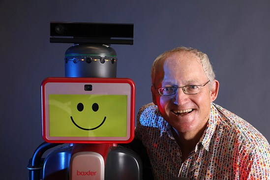 Toby Walsh with Baxter the robot