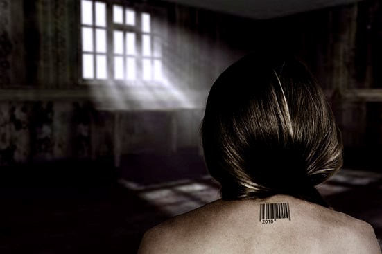 View of woman's back with barcode tattoo neck