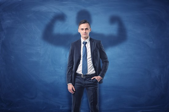 Business man with shadow showing muscles