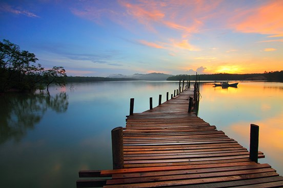 Sunrise over lake with pier
