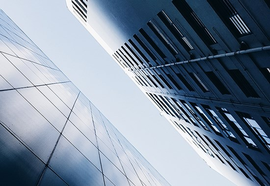 Abstract view looking upwards at buildings