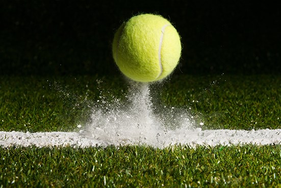 Close up of bouncing tennis ball