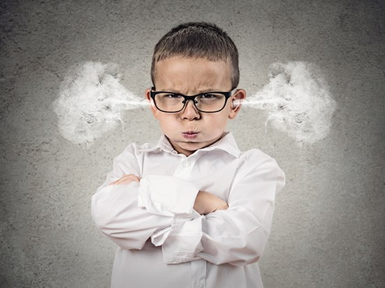 Little boy dressed in corporate clothes with steam coming out of his ears